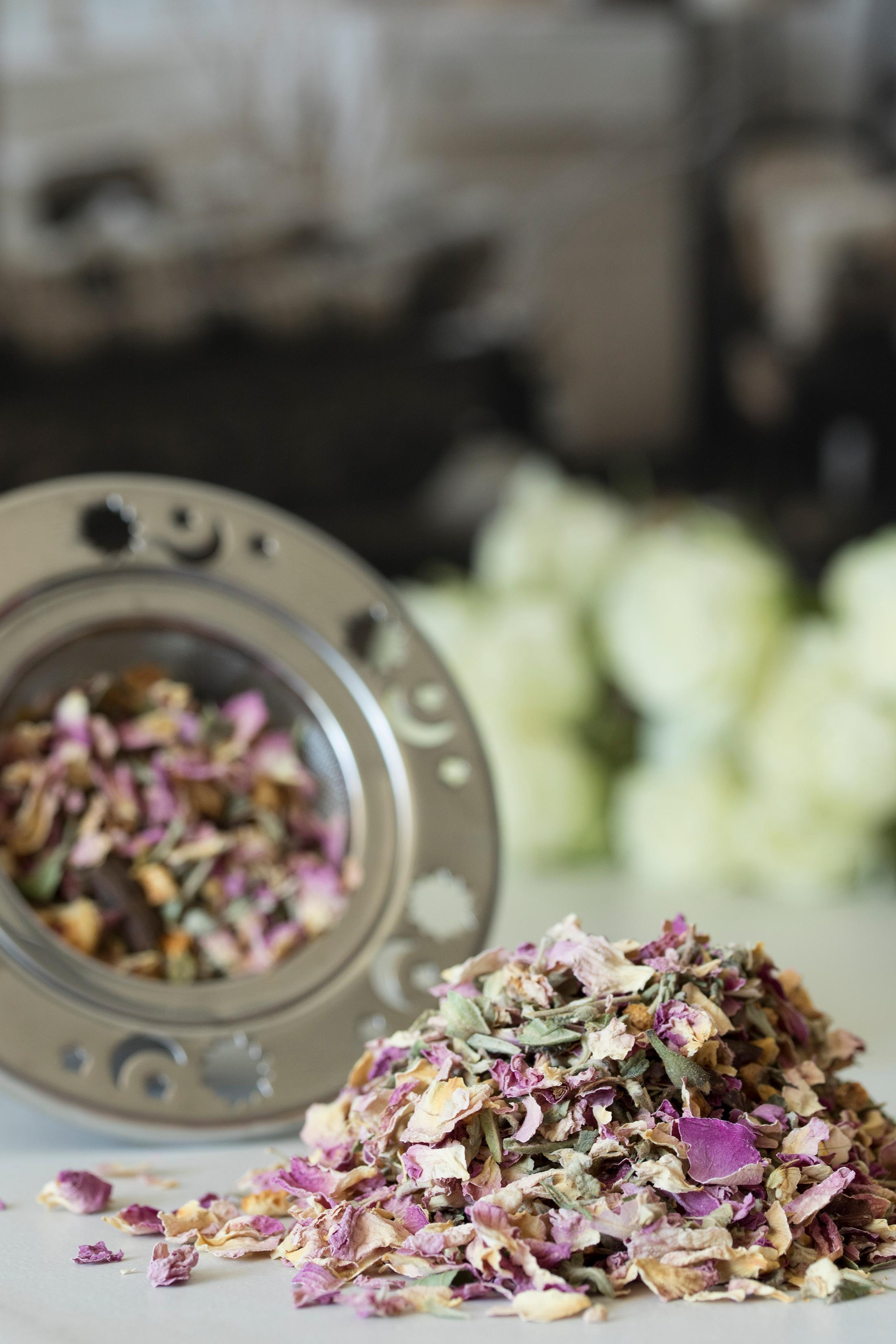 Loose-leaf love tea next to celestial tea strainer