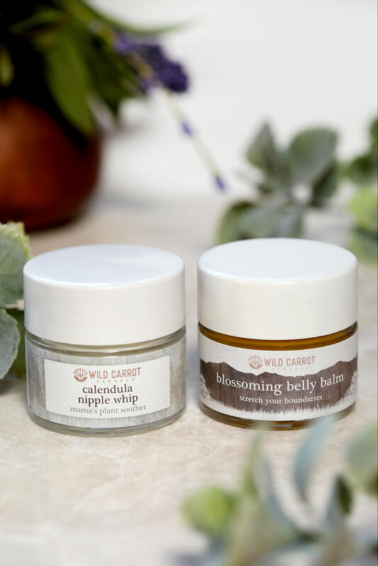 Jars of natural belly balm and nursing cream for new moms.