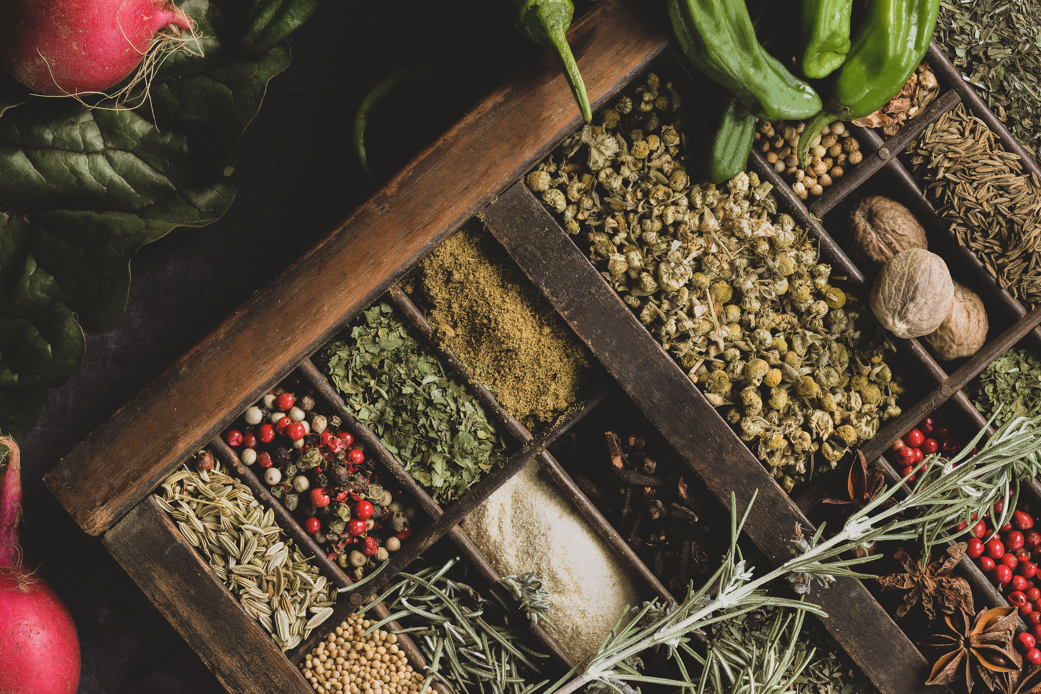 Dried colorful herbs and spices in a beautiful display.