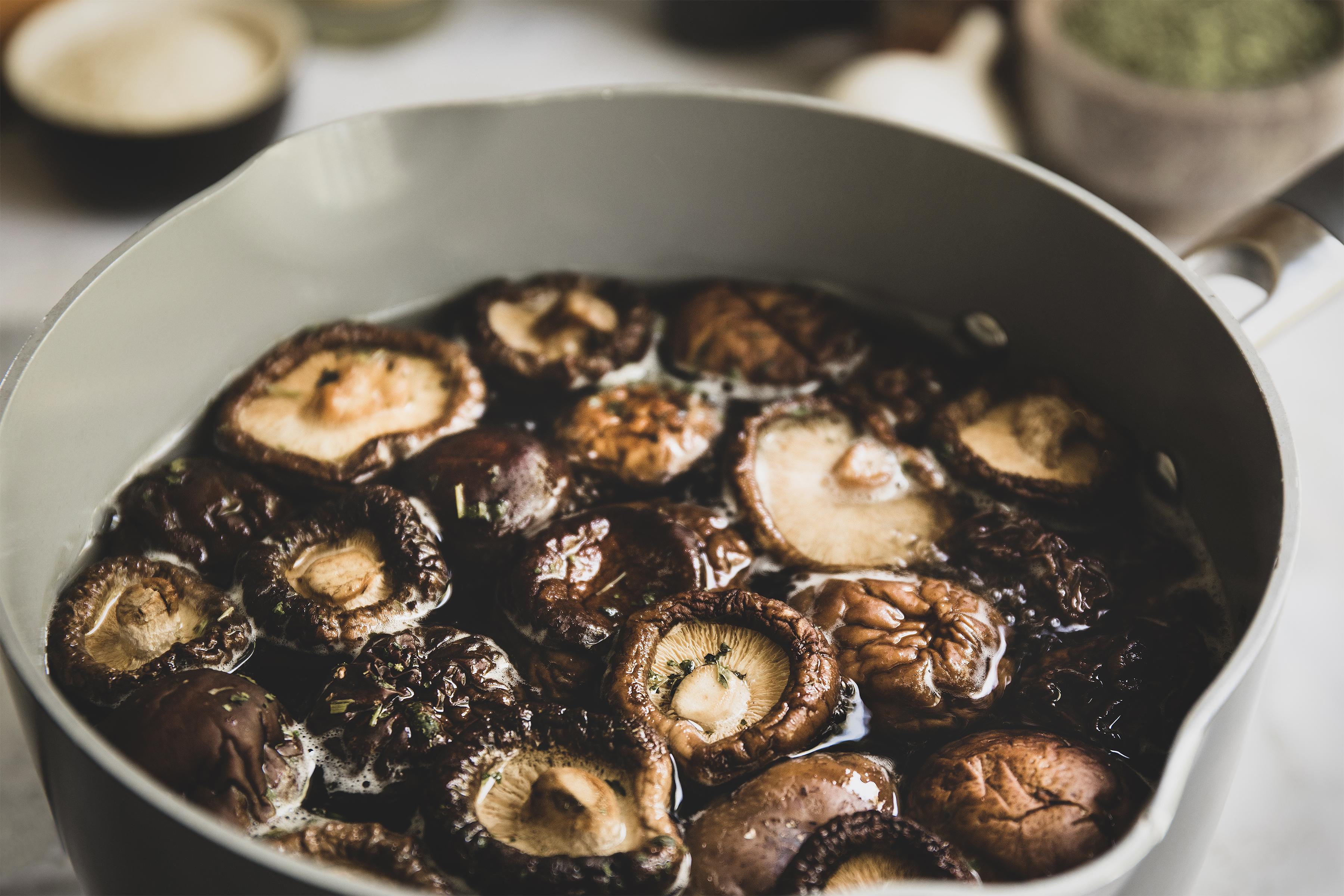 Bowl of shiitake mushrooms soaking in water.