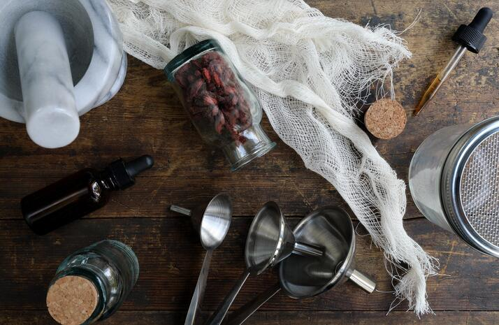Herbal and culinary tools laying out on wooden table