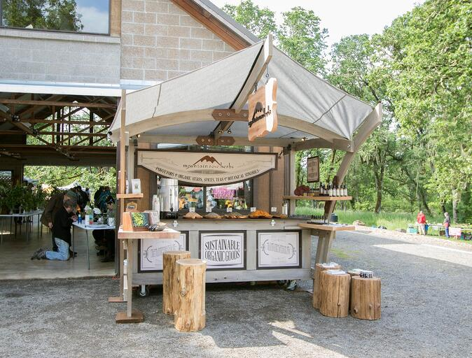 Outdoor Mountain Rose Herbs store booth outside Mt. Pisgah arboretum