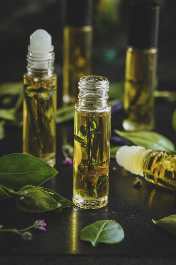 Perfume infusing in roll top bottles