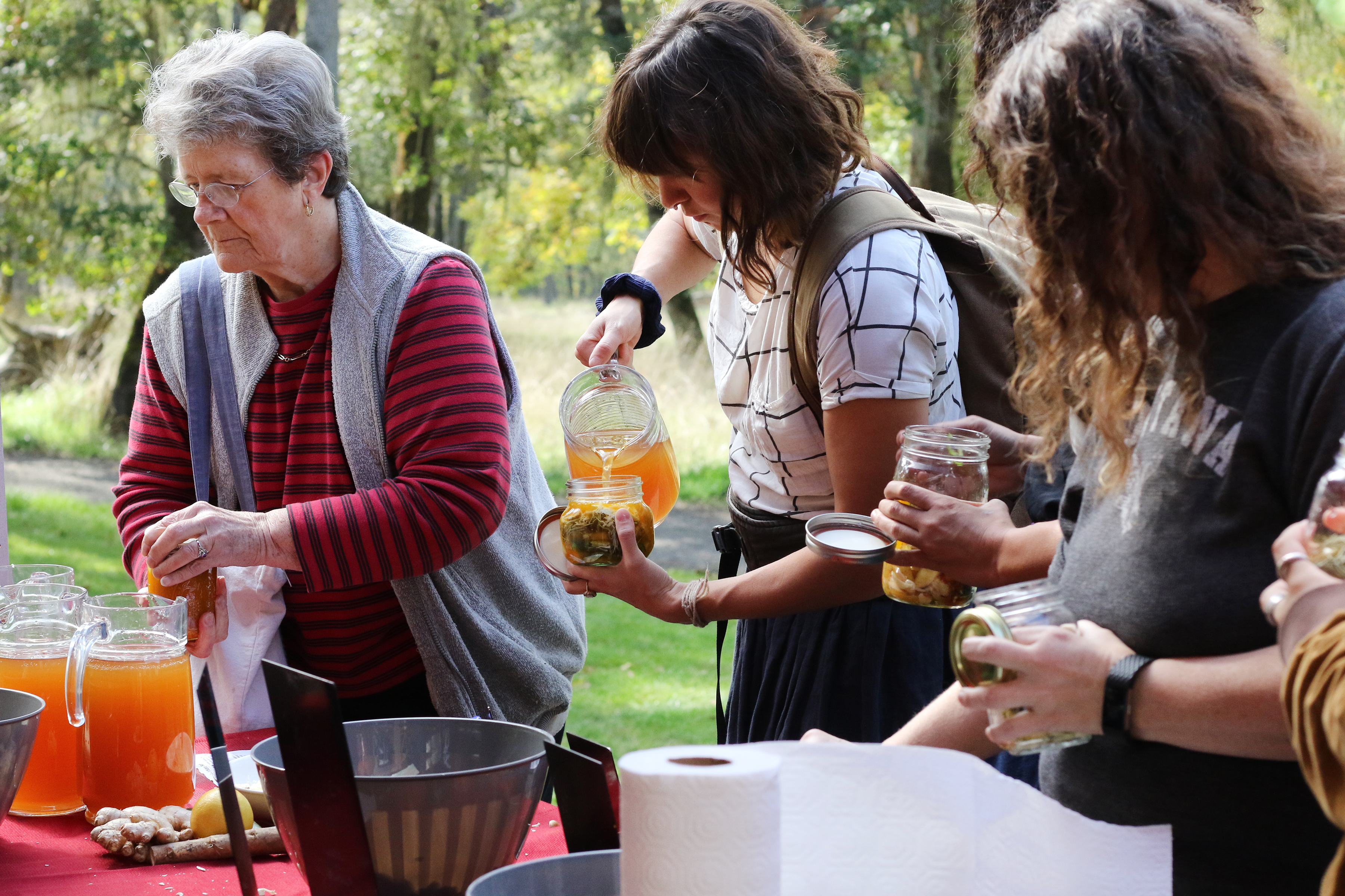 Community members pouring tea