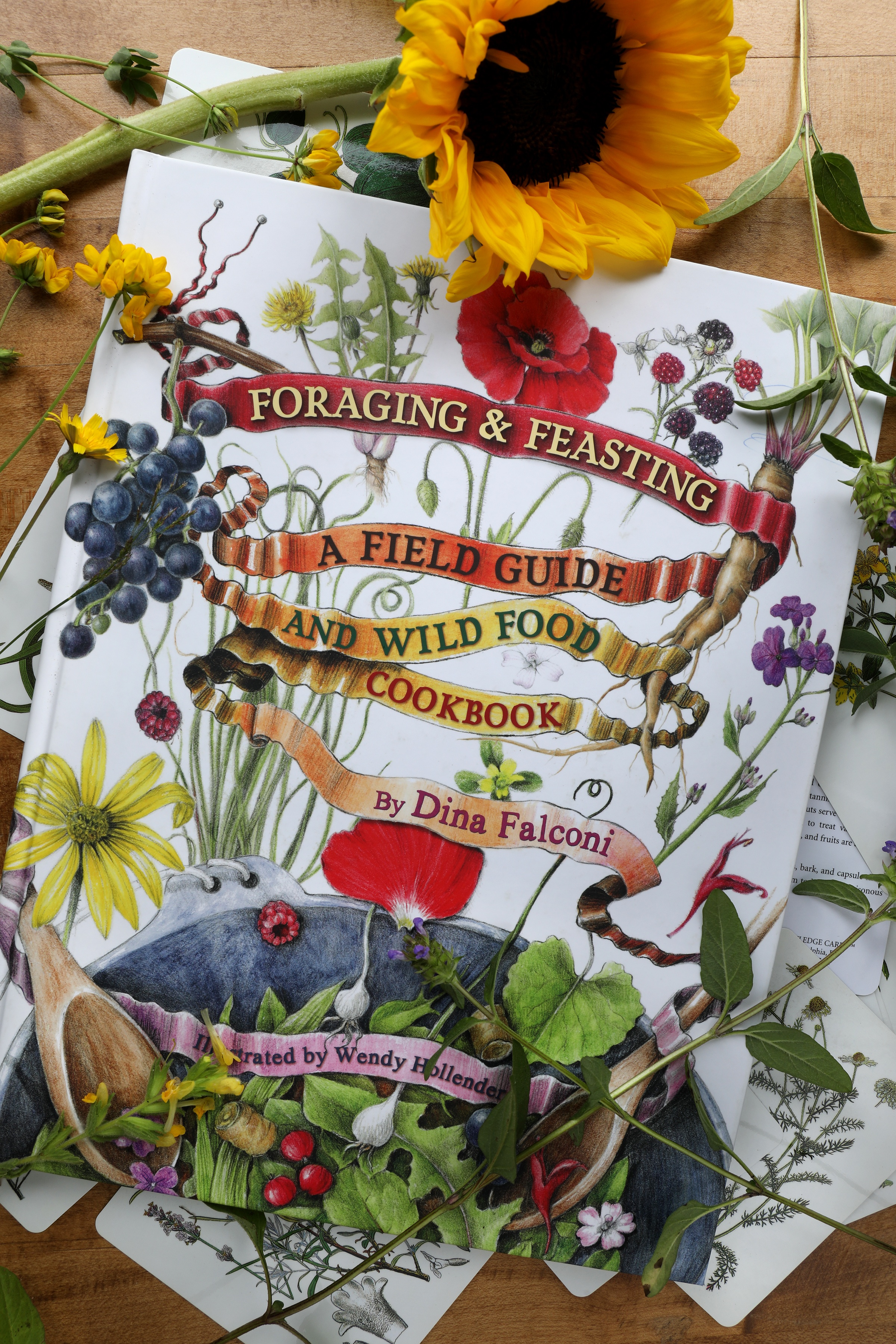 Foraging and Feasting guide for finding wild food book laying out on desk