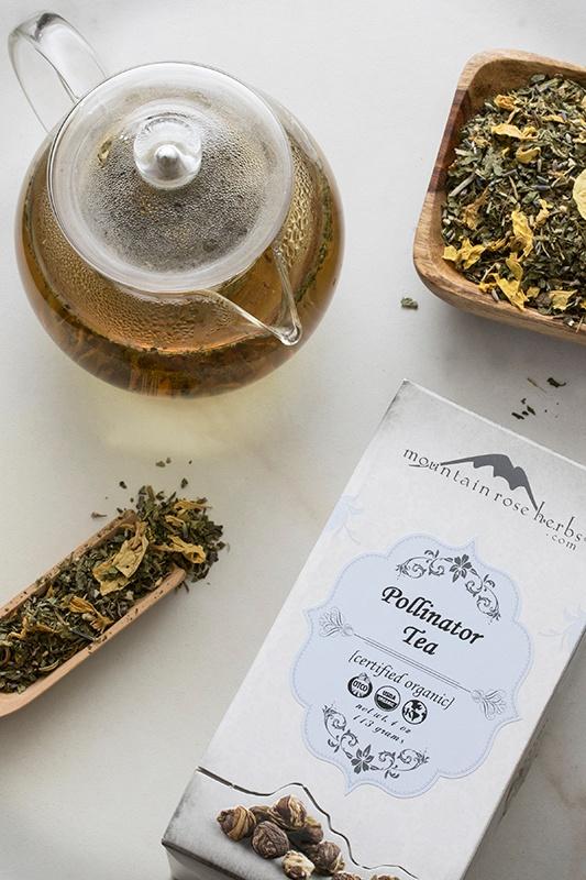 Certified organic pollinator tea in box and brewed in glass teapot