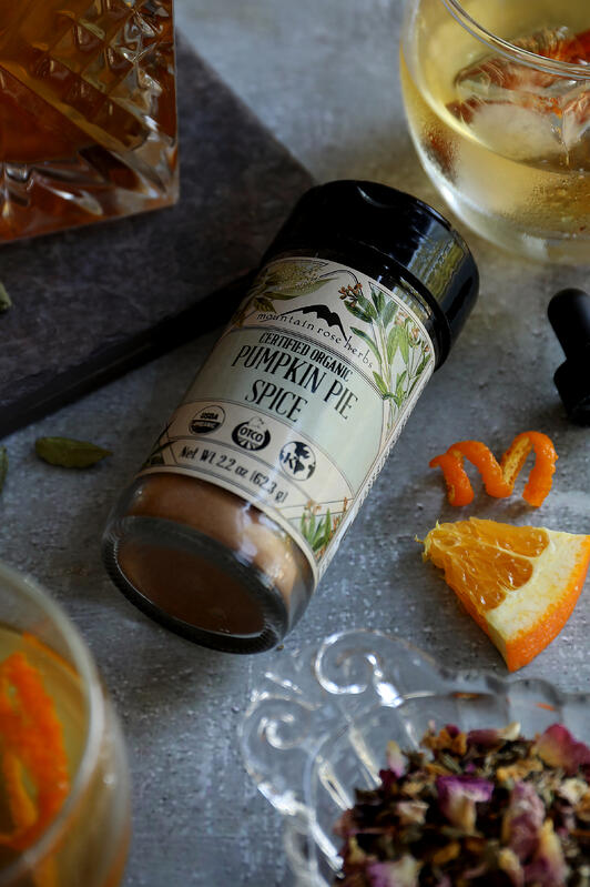 Organic pumpkin pie spice blend from Mountain Rose Herbs with fresh oranges and herbal teas to make a seasonal take on an old fashioned cocktail.