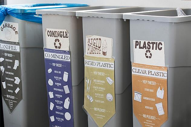 Different recycling bins for different types of plastics and garbage