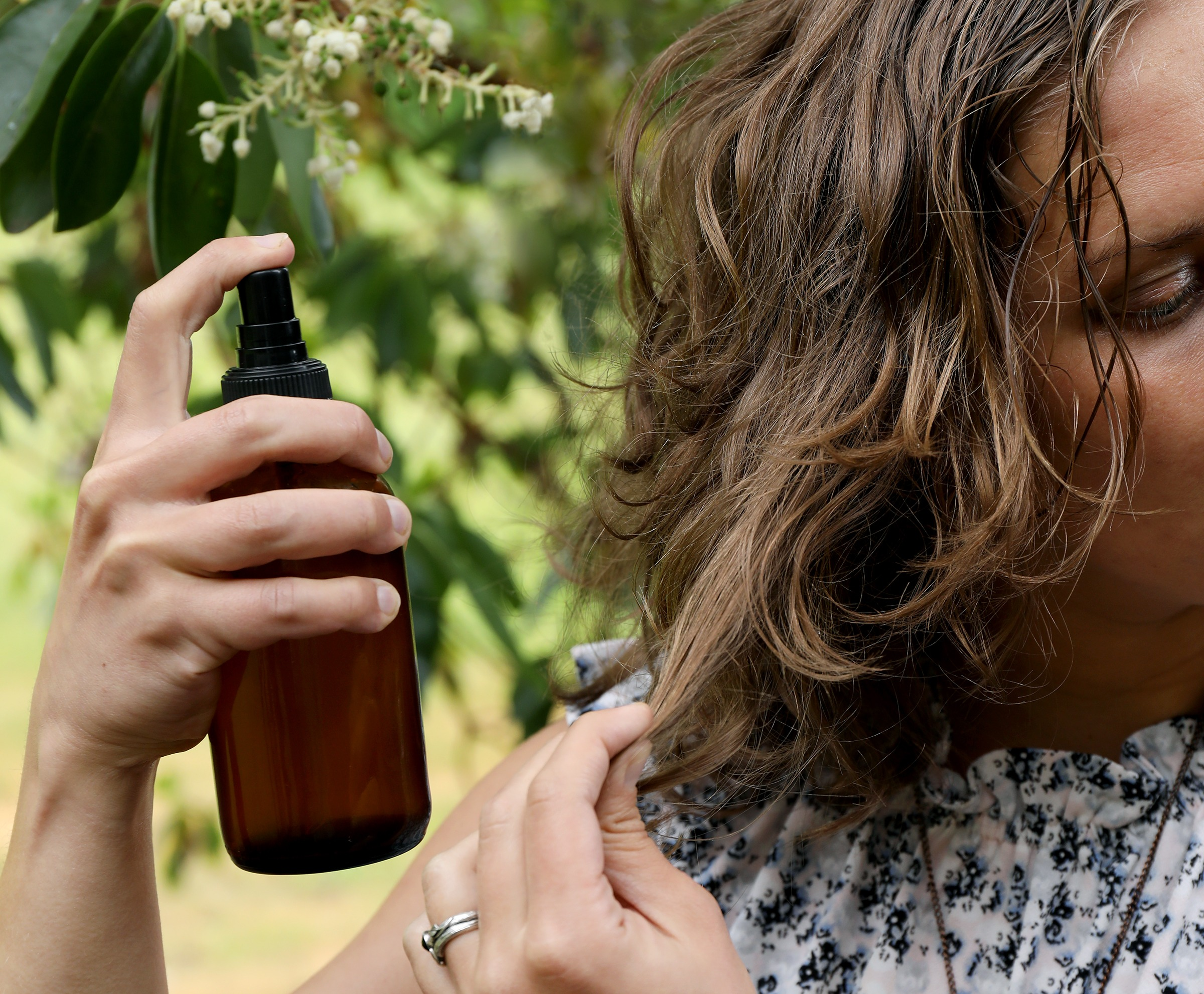 Homemade salt spray with essential oils and hydrosols for styling hair naturally.