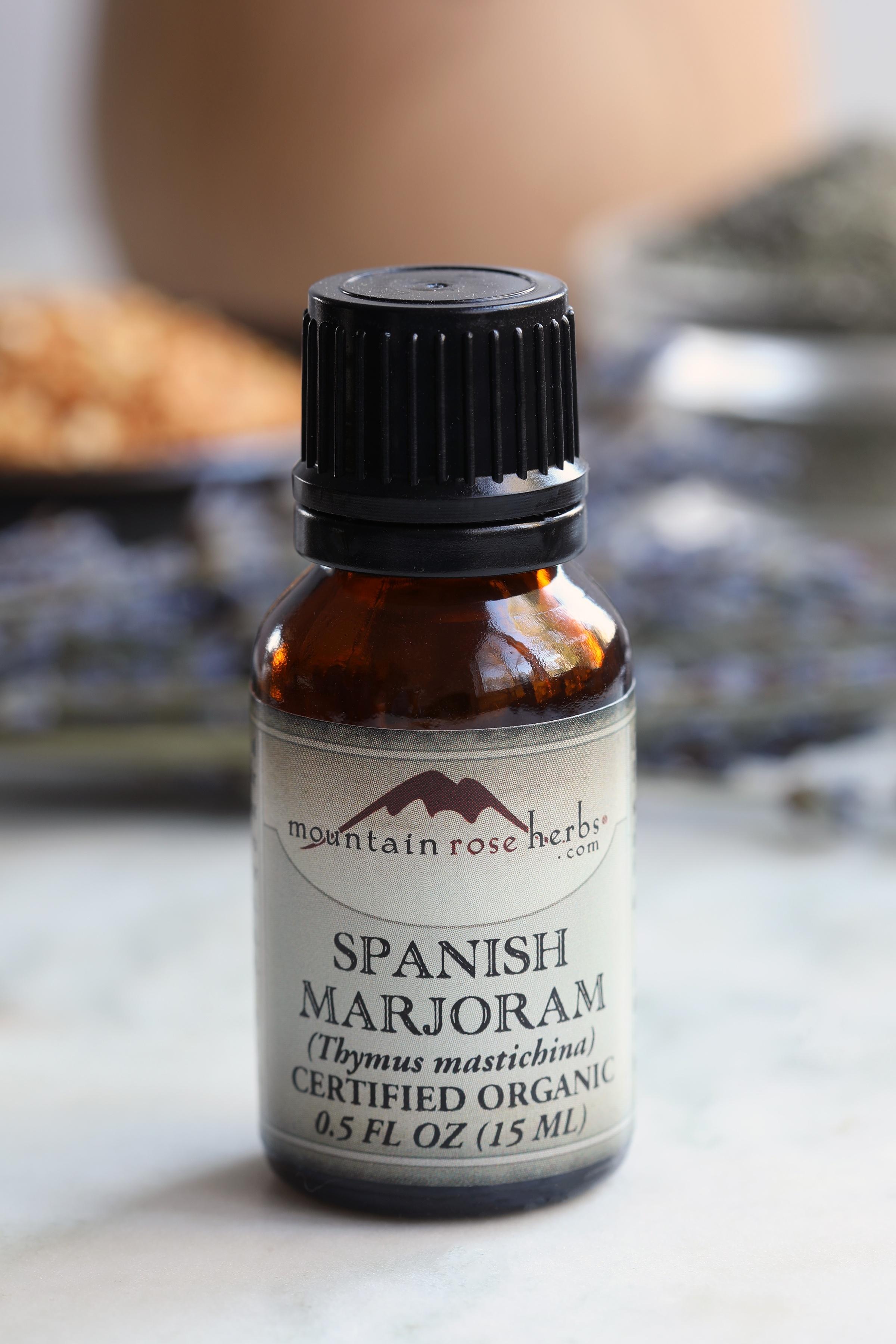 Half ounce bottle of spanish marjoram essential oil sitting on counter