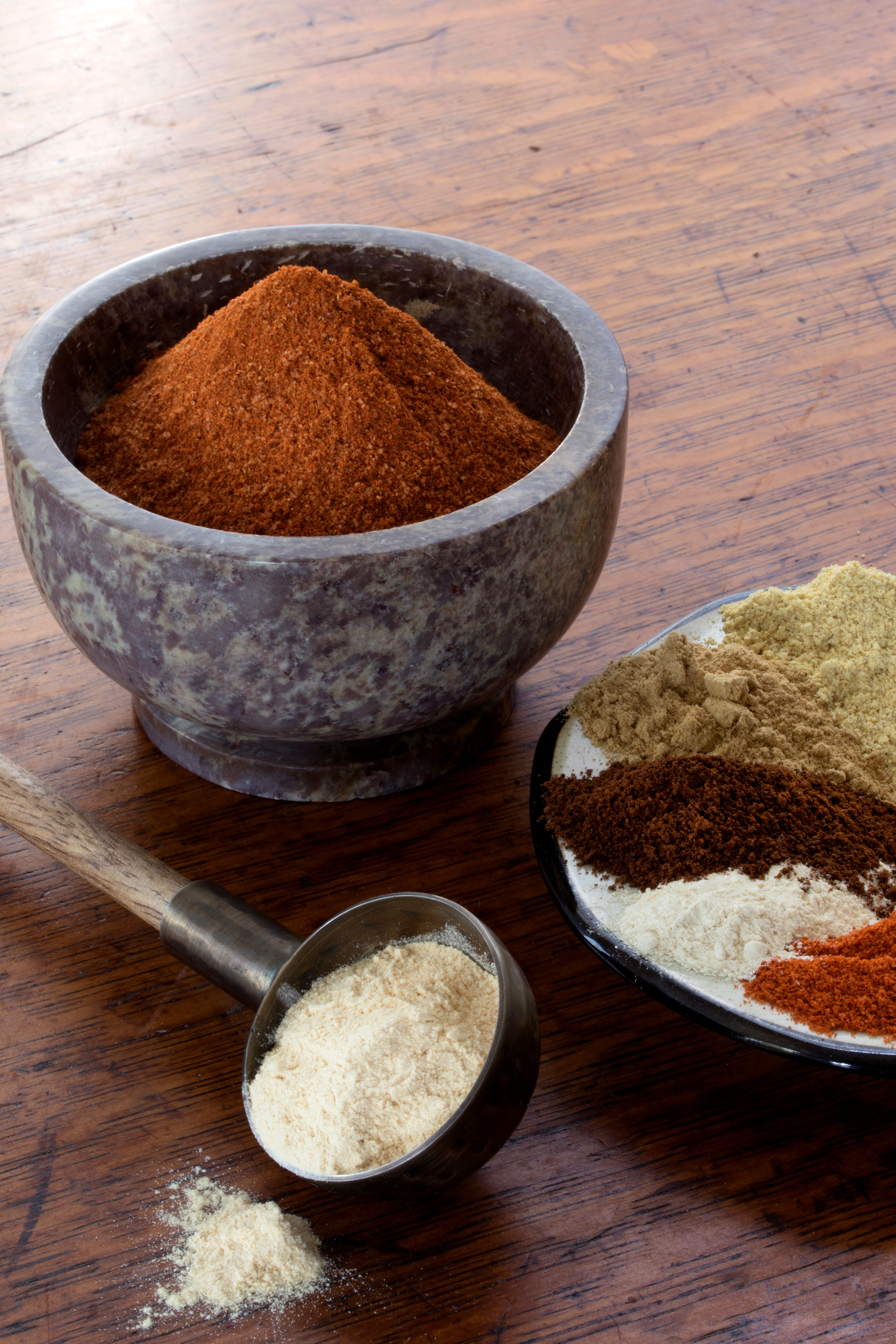 World Spice Blend Ethiopian Berbere In A Mortar With Ingredients In A Plate