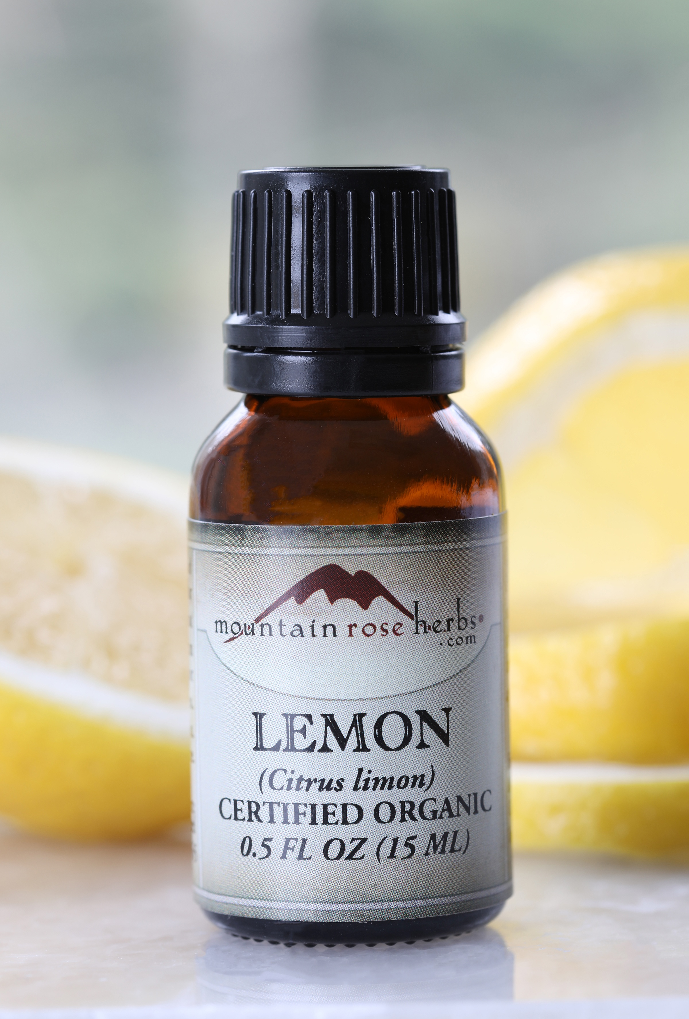 Half ounce glass amber bottle of lemon essential oil for spring cleaning