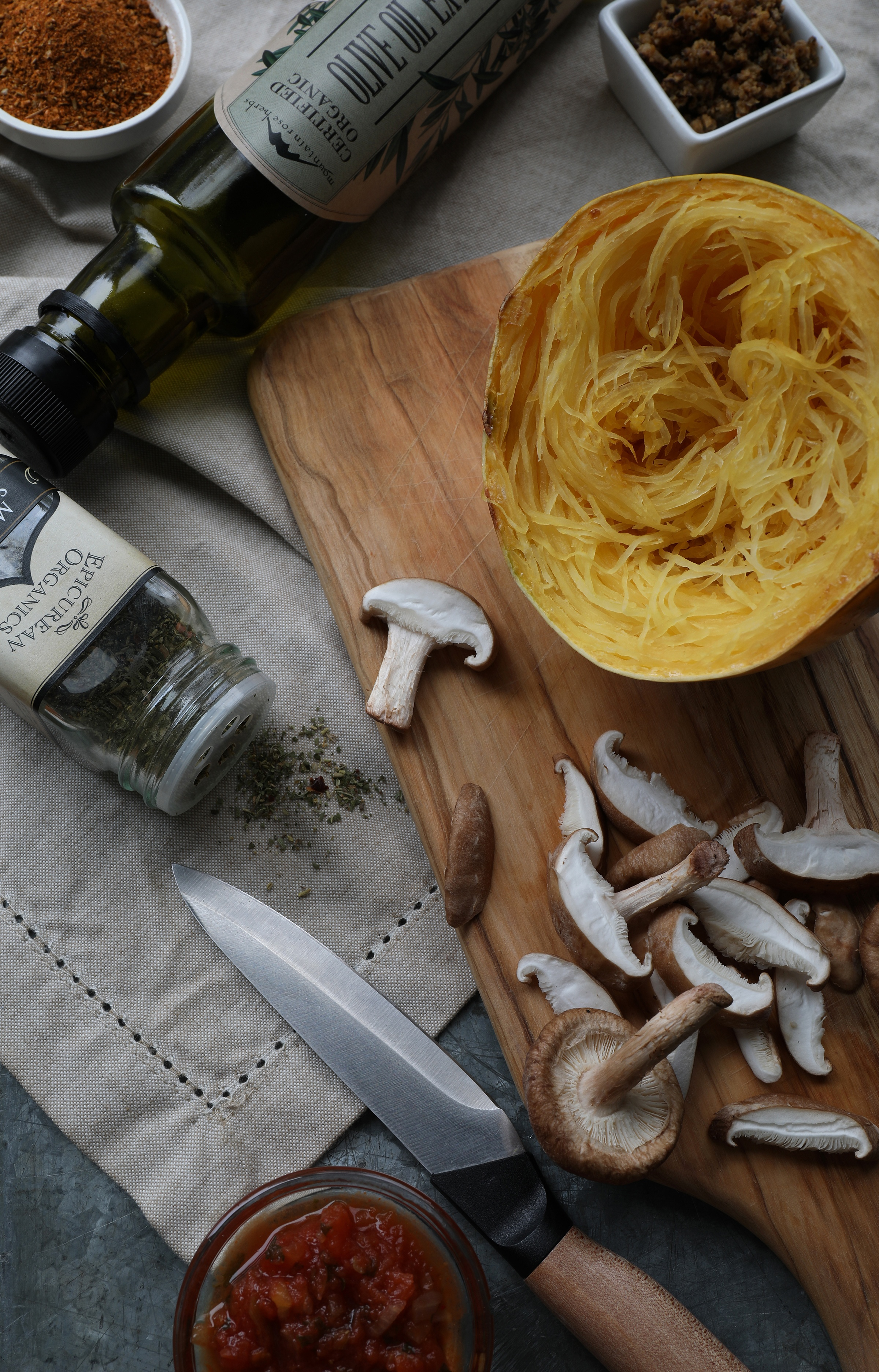 Ingredients laying out on cutting board to make spaghetti squash bowls