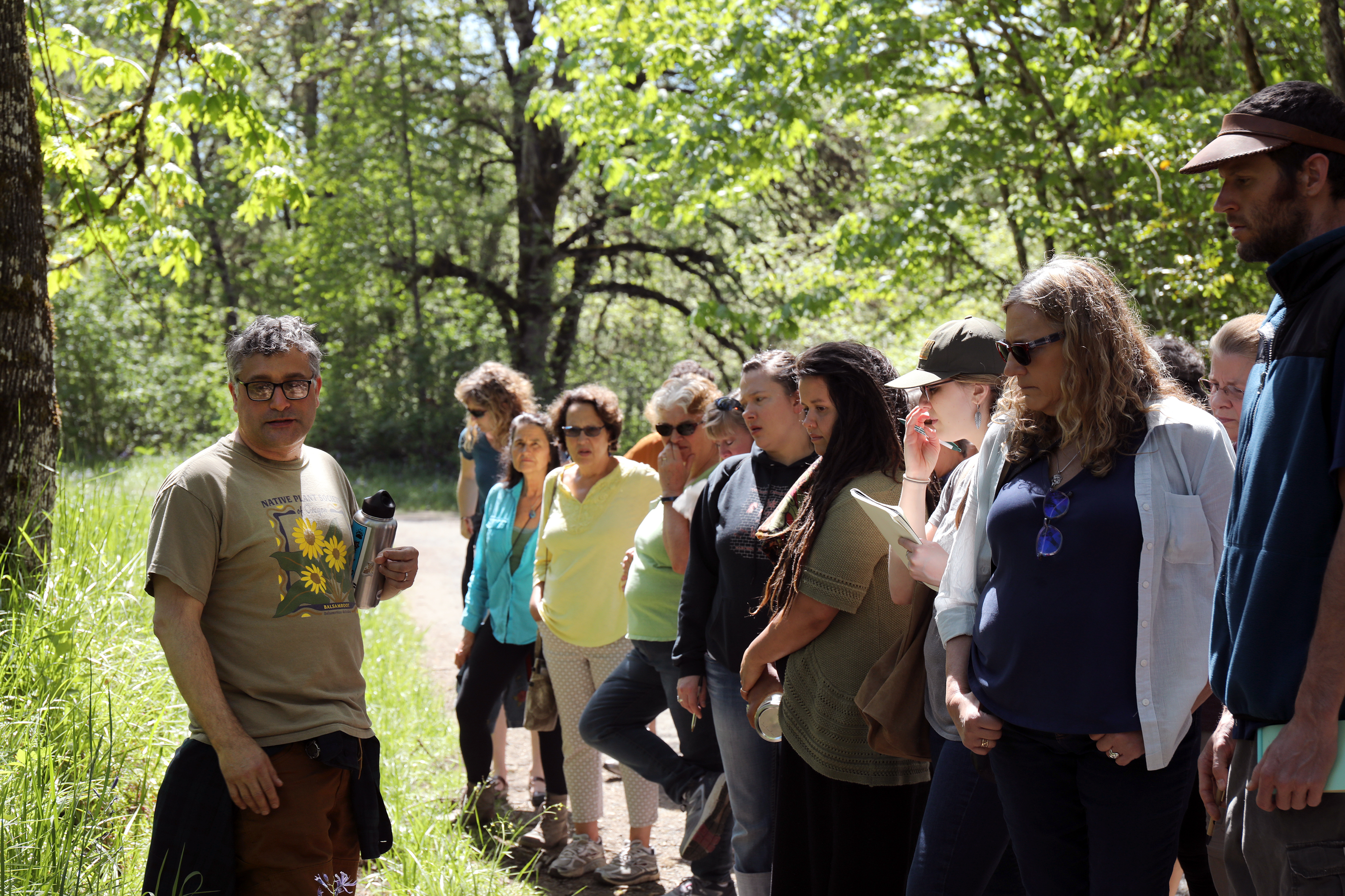 Quality control director, Steven Yaeger, takes participants on a plant identification walk in natural areas in Eugene, Oregon. Identifying plants is important to the botanical trade.