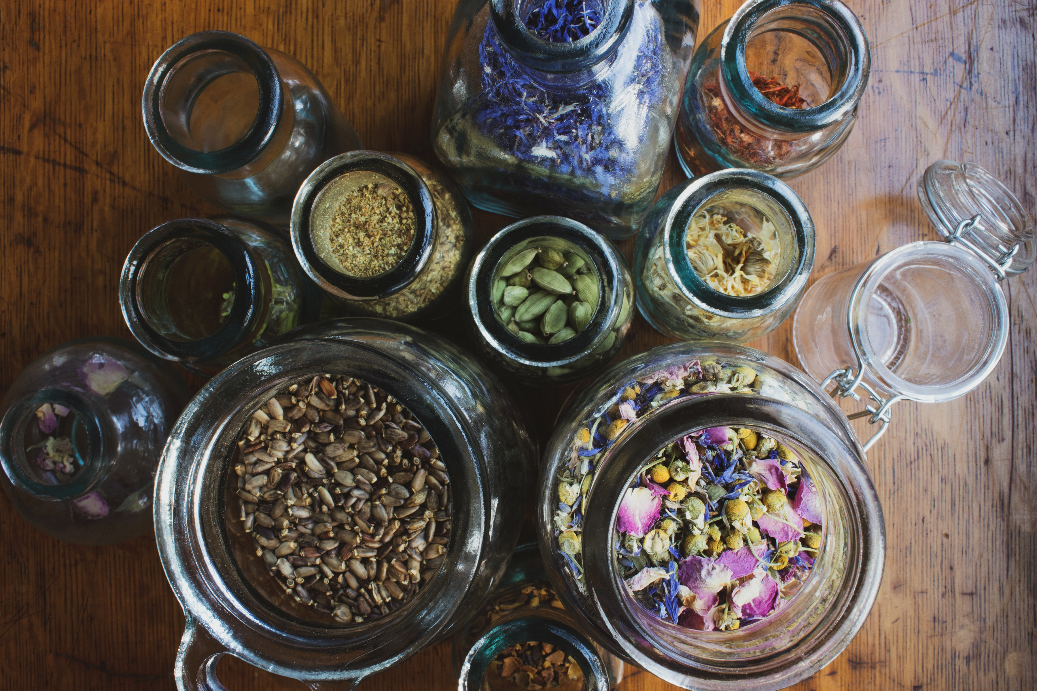 herbs in open glass jars