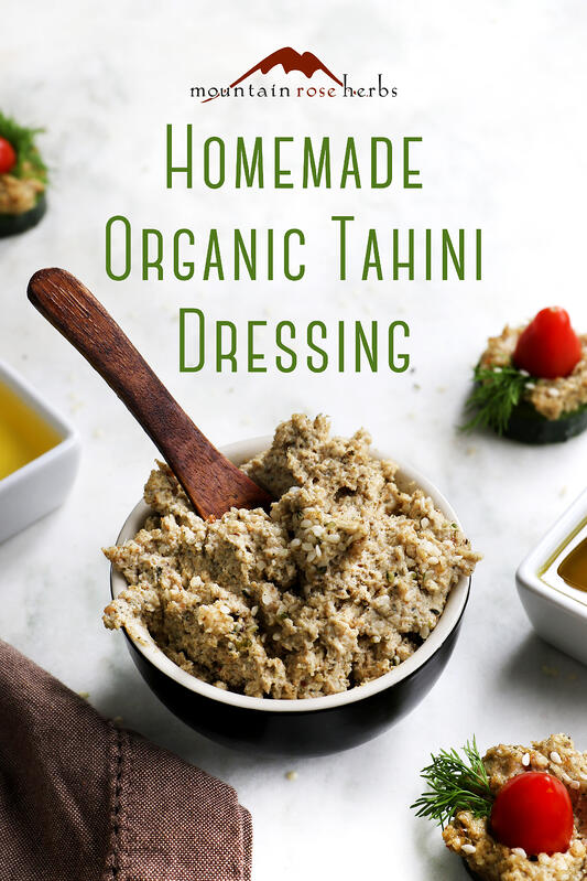A bowl of diy organic tahini spread made with hemp seeds, sesame seeds, pumpkin seed oil, and sesame seed oil.