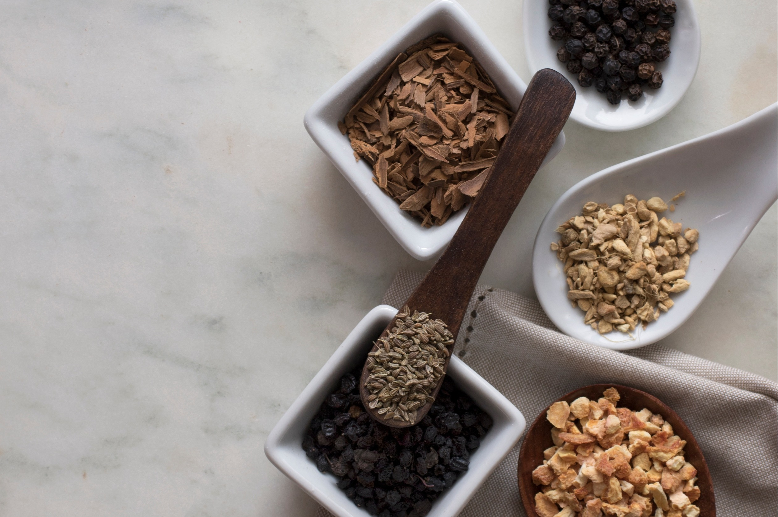 Herbs and spices come together to make delicious tea blends for any occasion. Seeds, dried berries, citrus peel, and aromatic roots can all be incorporated into tea blends for health and happiness.