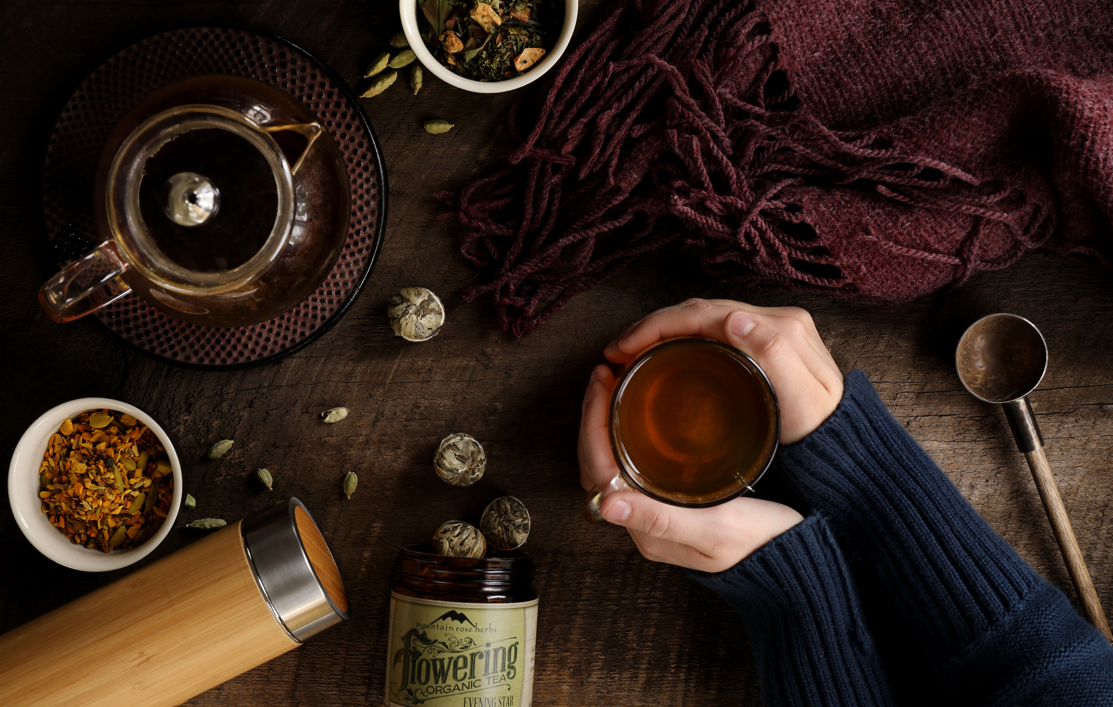 Gifts for tea lovers include flowering teas and a clear glass teapot, travel tea tumblers in bamboo, and other accessories for any tea enthusiast.