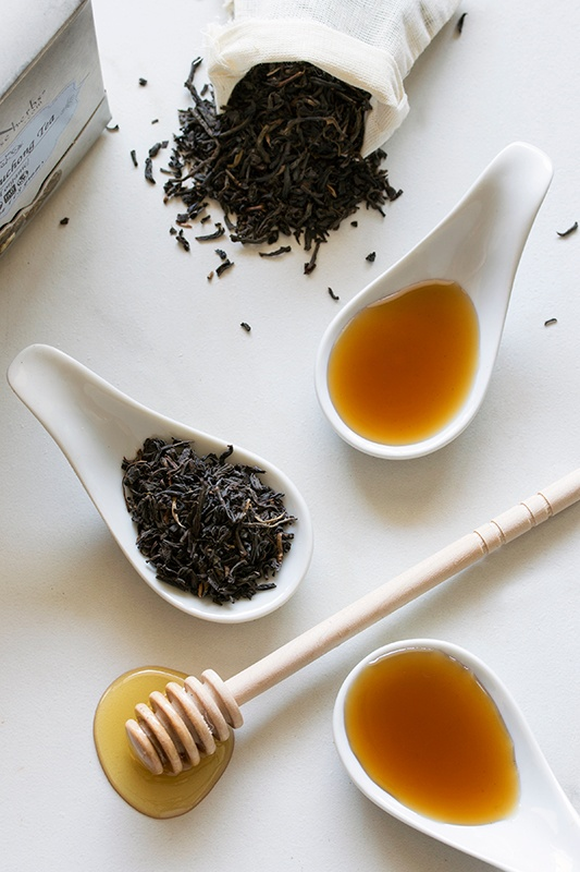 Spoonfuls of lapsang souchang tea, honey, and syrups
