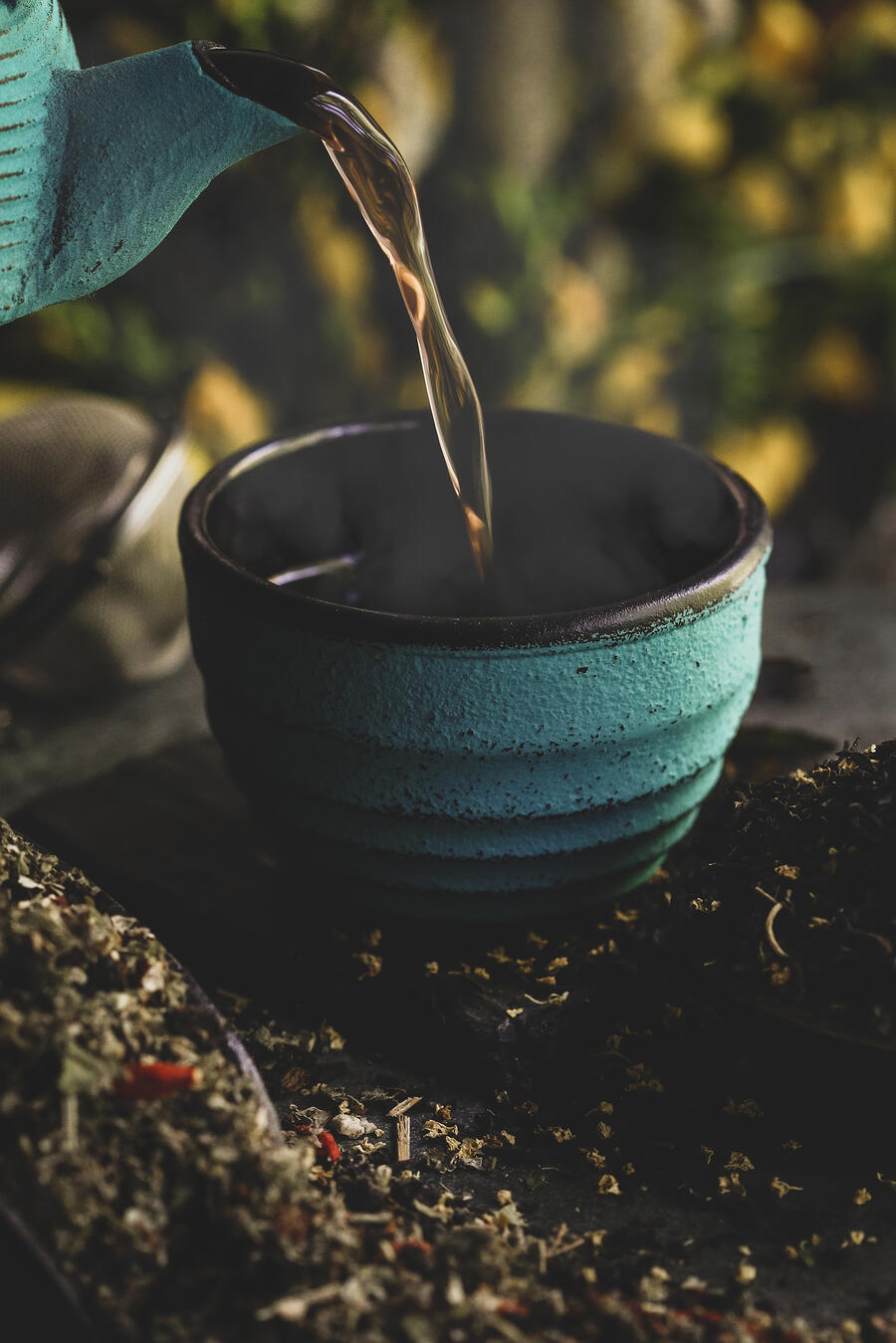 A tea pot pouring tea.