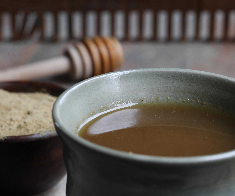 Ceramic mug filled with triphala water