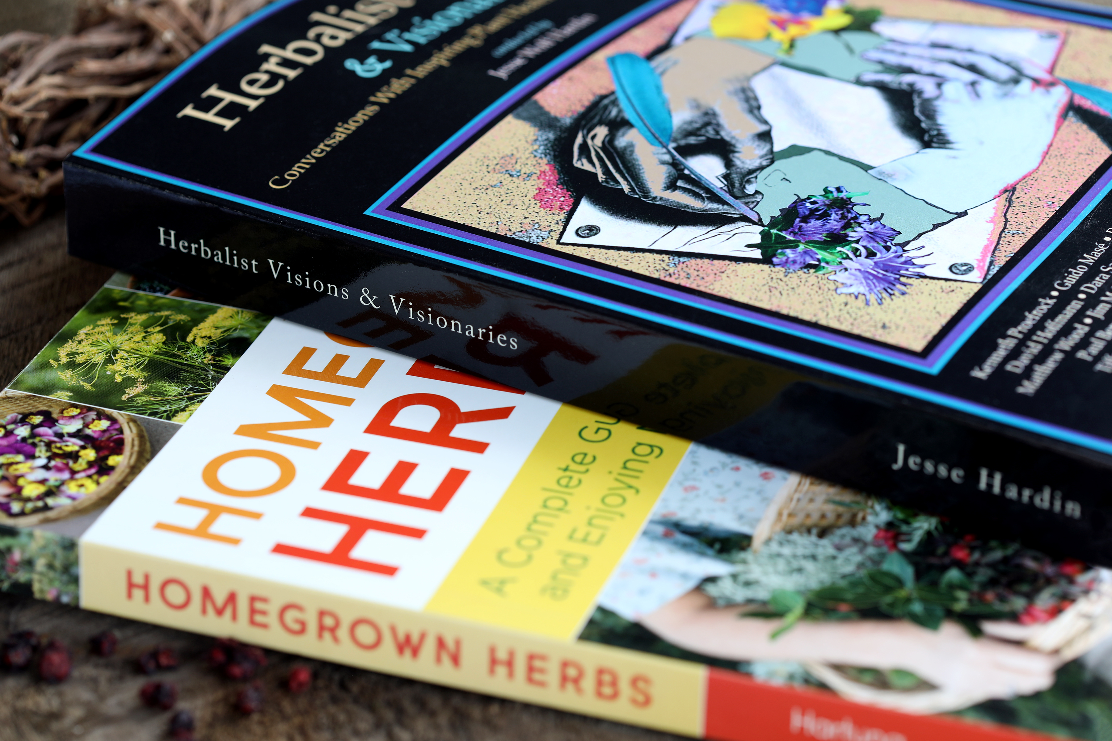 Close up photo of two colorful books on herbs and herbalists