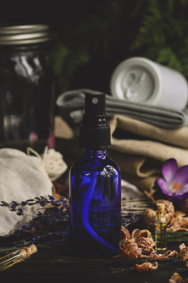 Blue spray bottle with natural ingredients
