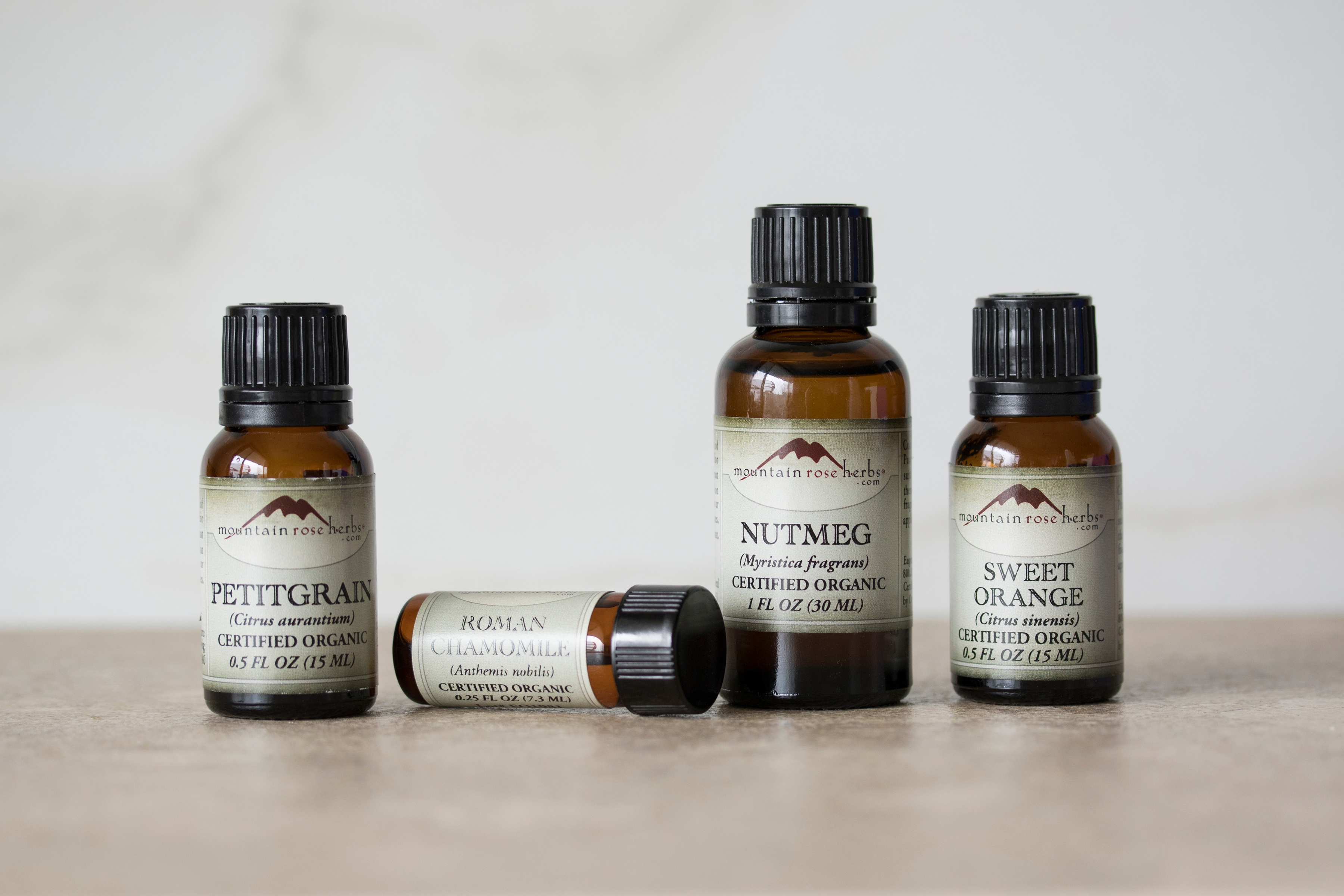 Bottles of essential oils in warm setting