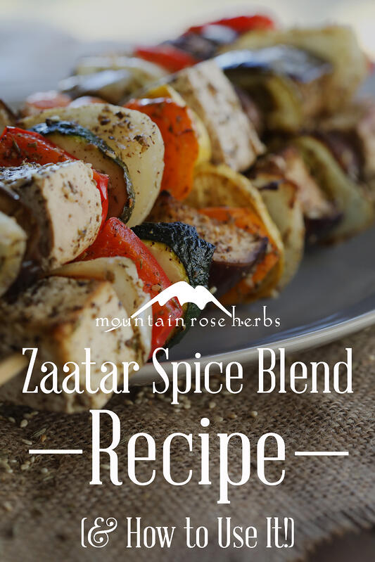 Pinterest Pin of grilled vegetable kebabs on a plate sprinkled with Middle Easter za'atar spice blend.