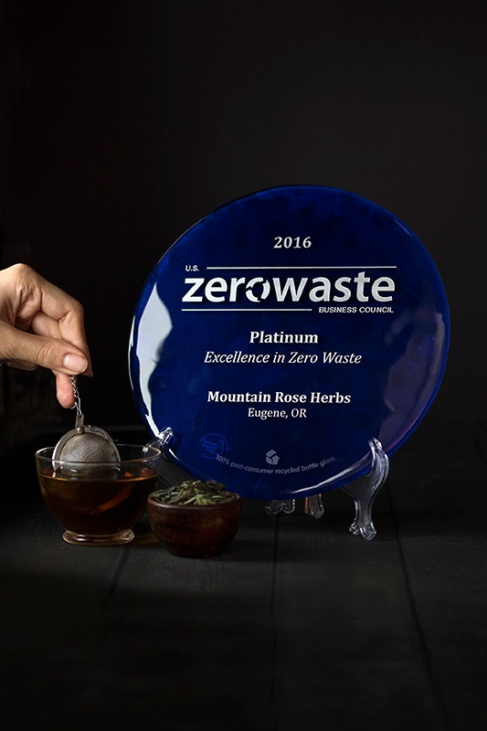 hand steeping organic tea next to zero waste platinum award