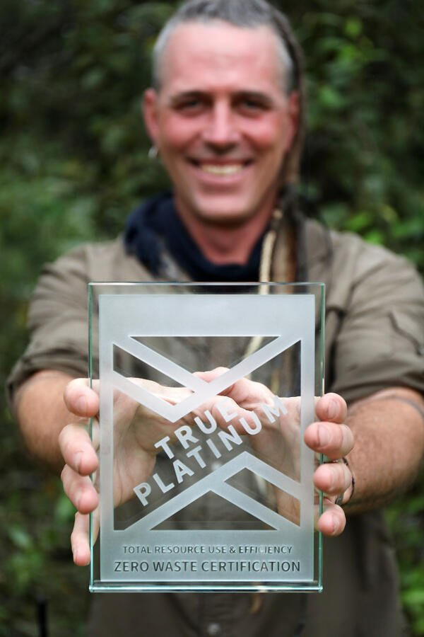 Shawn Donille, Vice President of Mountain Rose Herbs, holding the Platinum winner TRUE Zero Waste company award.