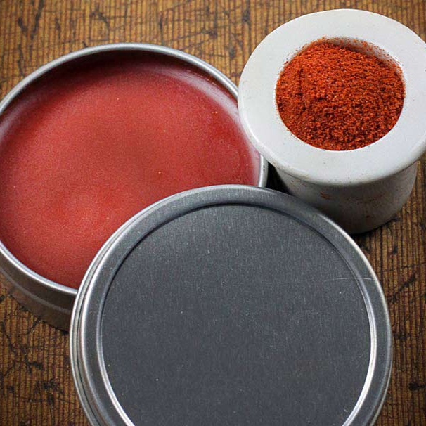 Red Salve made from Cayenne in a tin and Cayenne Pepper