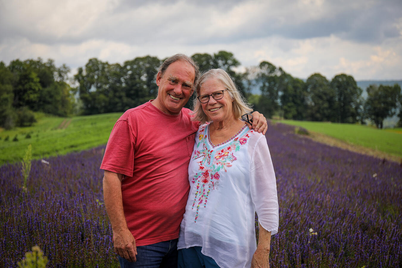 The owners of Foster Farm on their land in Vermont.