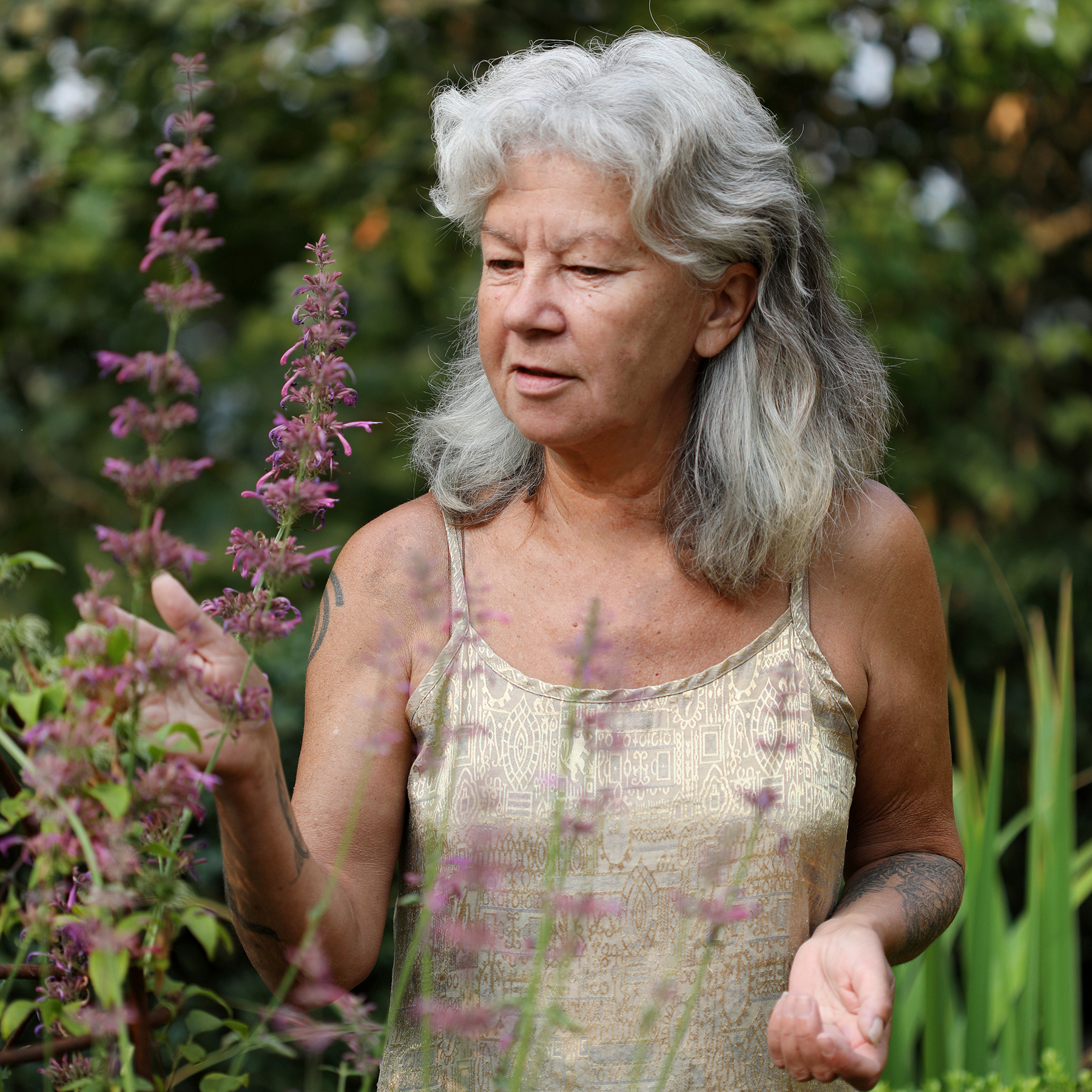 Mountain Rose Herbs co-owner Julie Baliey walks through her home garden of herbs in Eugene, Oregon.