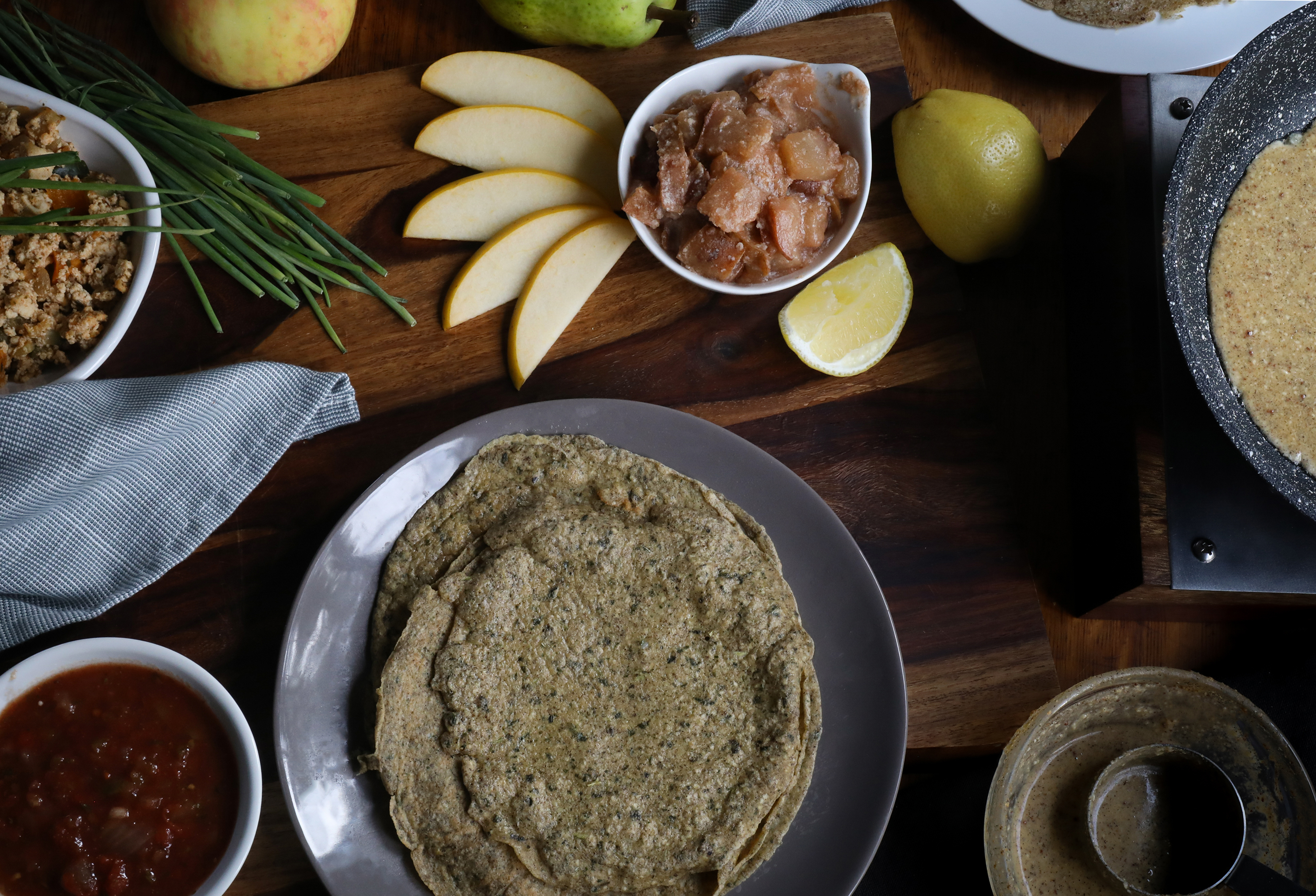 Gluten-free coconut buckwheat crepes on a plate with apple filling and sliced pears