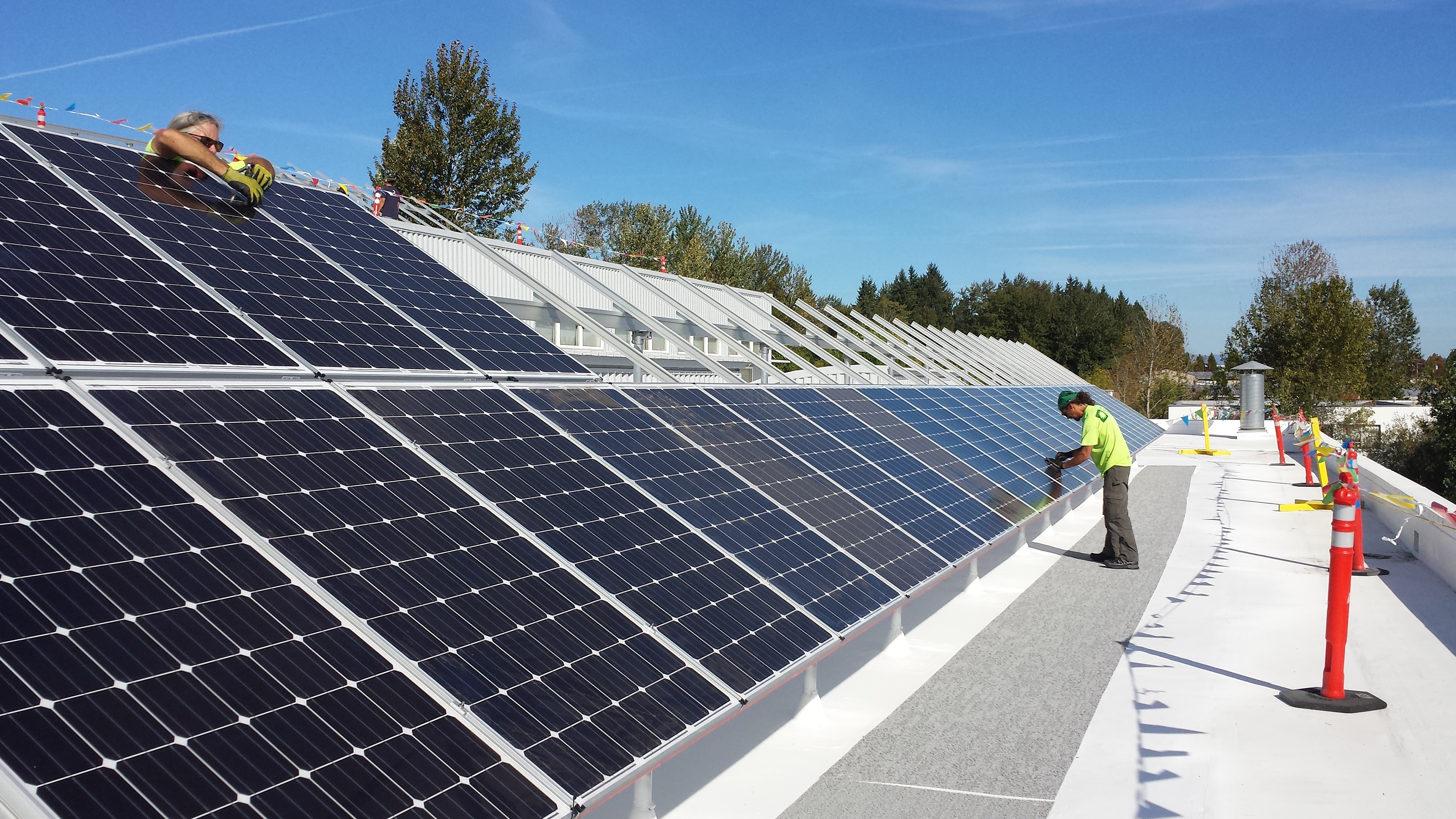 Long rows of solar panels are installed at a LEED certified building in Oregon.