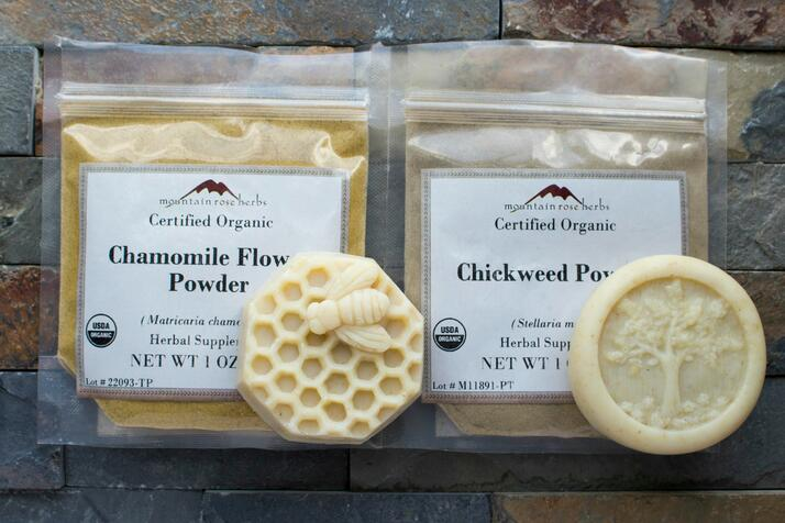 Sealed bags filled with Mountain Rose Herbs chamomile flower powder and chickweed powder